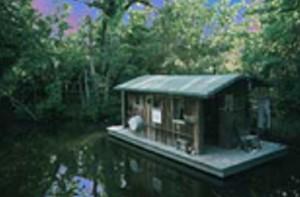 Pure Cajun Houseboat logo